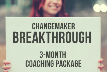 change maker breakthrough woman smiling holding sign