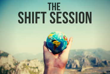 the shift session, hand holding globe