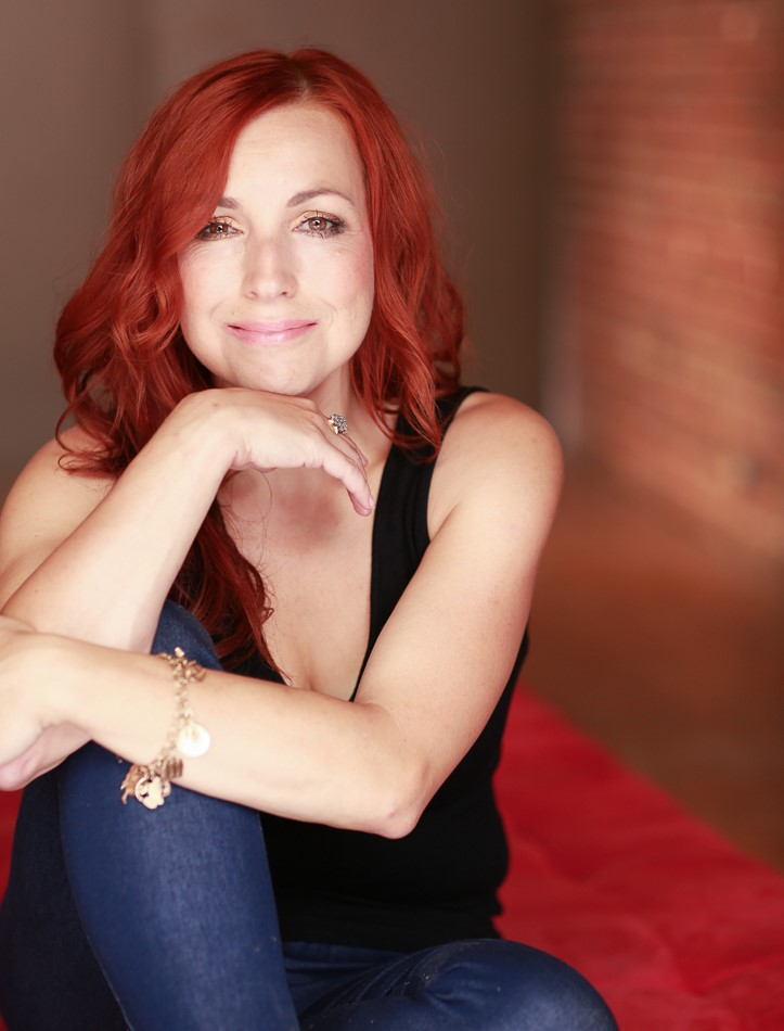Kimberly Carroll, woman smiling with red hair